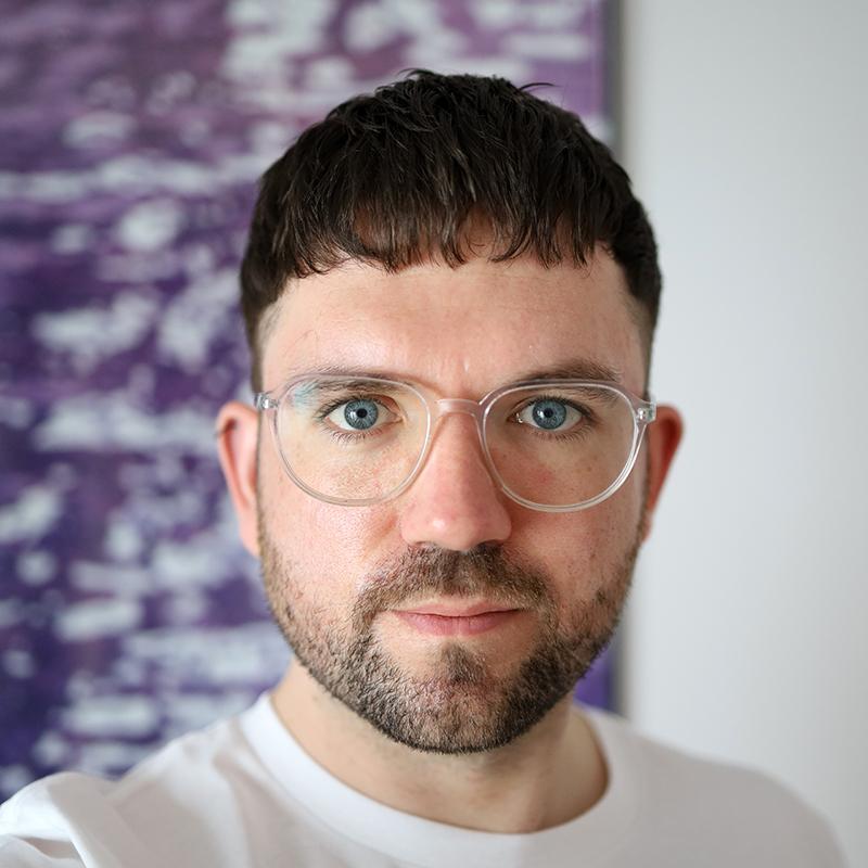 Das Bild zeigt den Referenten Nicholas Potte, der in direkt in die Kamera schaut © Nicholas Potter, 2021